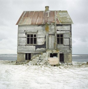 photo of dilapidated house on the beach